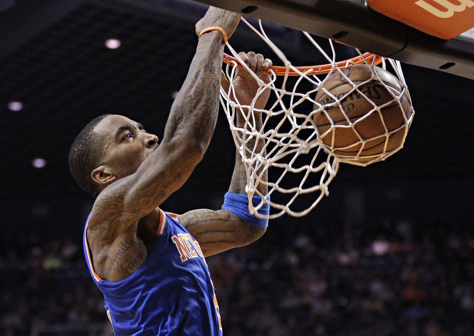 New York Knicks' J.R. Smith dunks against the Phoenix Suns during the first half of an NBA basketball game on Wednesday, Dec. 26, 2012, in Phoenix. (AP Photo/Matt York)