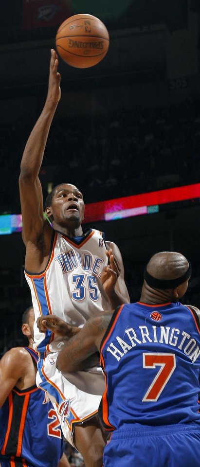 Kevin Durant (35) of Oklahoma City shoots over Al Harrington (7) of New York during the NBA basketball game between the Oklahoma City Thunder and the New York Knicks at the Ford Center in Oklahoma City, Monday, January 11, 2010. Oklahoma City won, 106-88. Photo by Nate Billings, The Oklahoman