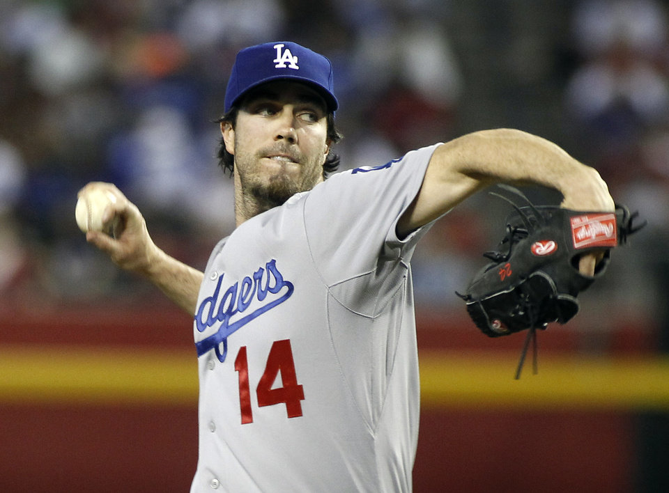 Photo - Los Angeles Dodgers' Dan Haren delivers against the Arizona Diamondbacks during the second inning of a baseball game on Sunday, April 13, 2014, in Phoenix. (AP Photo/Ralph Freso)