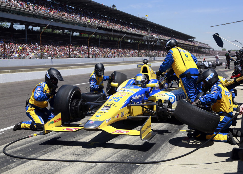 Photo - Marco Andretti pits during the 98th running of the Indianapolis 500 IndyCar auto race at the Indianapolis Motor Speedway in Indianapolis, Sunday, May 25, 2014. (AP Photo/R Brent Smith)