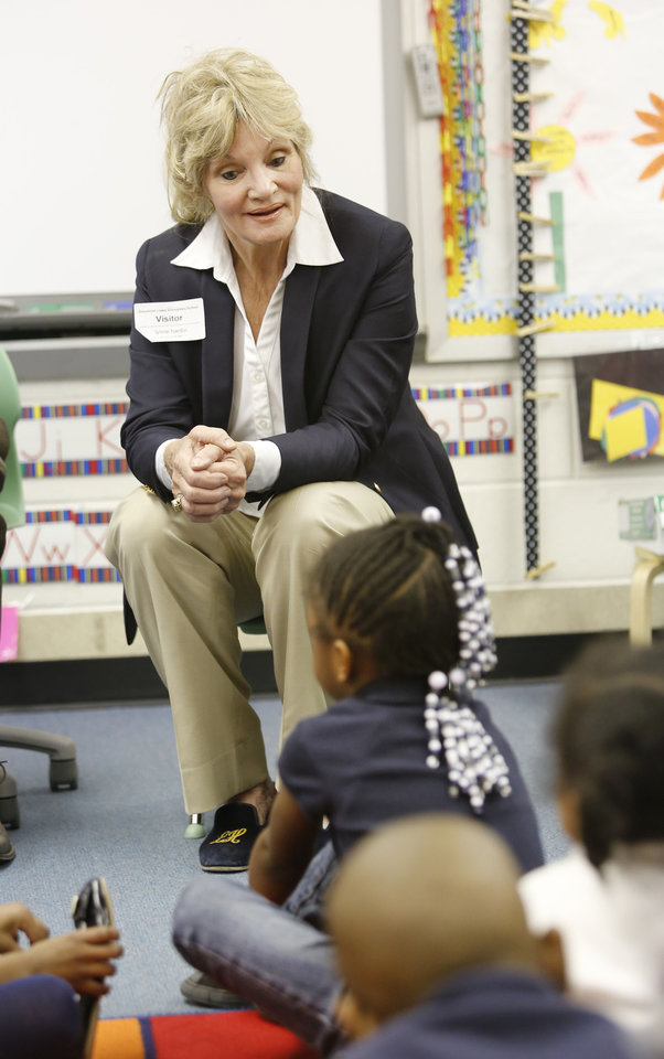 Photo - Lynne Hardin, chairwoman of the Oklahoma City School Board, talks Friday to pre-K students at Greystone Elementary School for National Drop Everything and Read Day. Photo By Steve Gooch, The Oklahoman