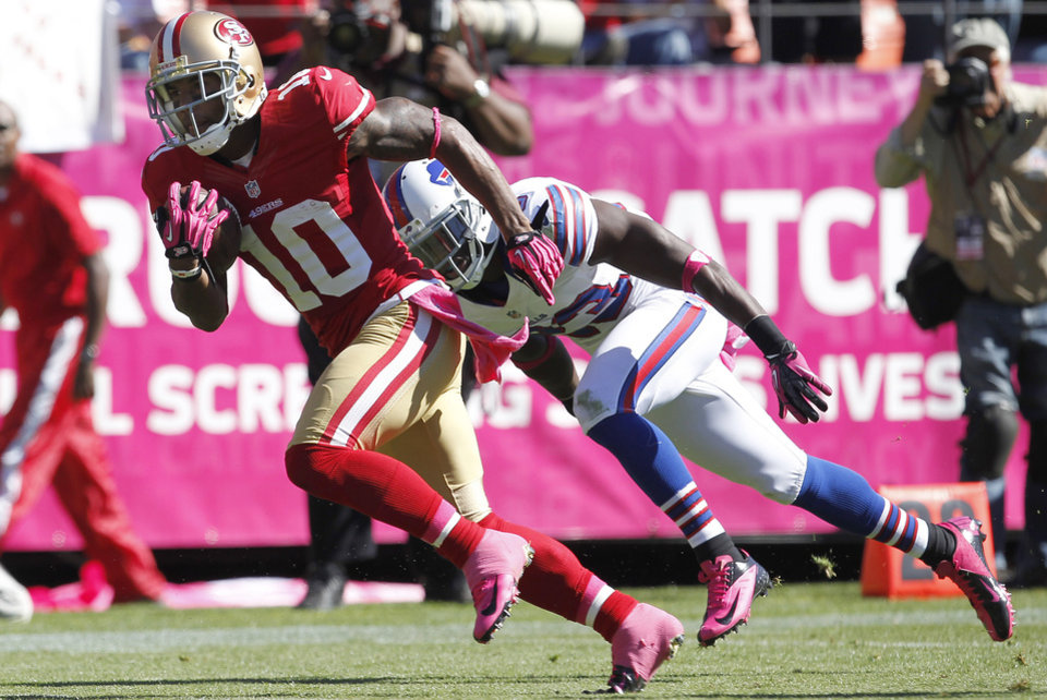 San Francisco 49ers wide receiver Kyle Williams (10) runs past Buffalo Bills cornerback Aaron Williams (23) to score on a touchdown pass from quarterback Alex Smith during the second quarter of an NFL football game, Sunday, Oct. 7, 2012, in San Francisco. (AP Photo/Tony Avelar)