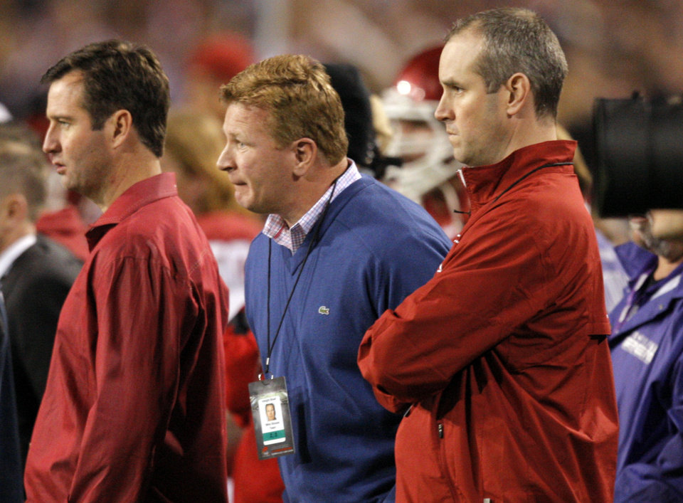 Photo - Mike Stoops watches game action during the Insight Bowl college football game between the University of Oklahoma (OU) Sooners and the Iowa Hawkeyes at Sun Devil Stadium in Tempe, Ariz., Friday, Dec. 30, 2011. Photo by Sarah Phipps, The Oklahoman