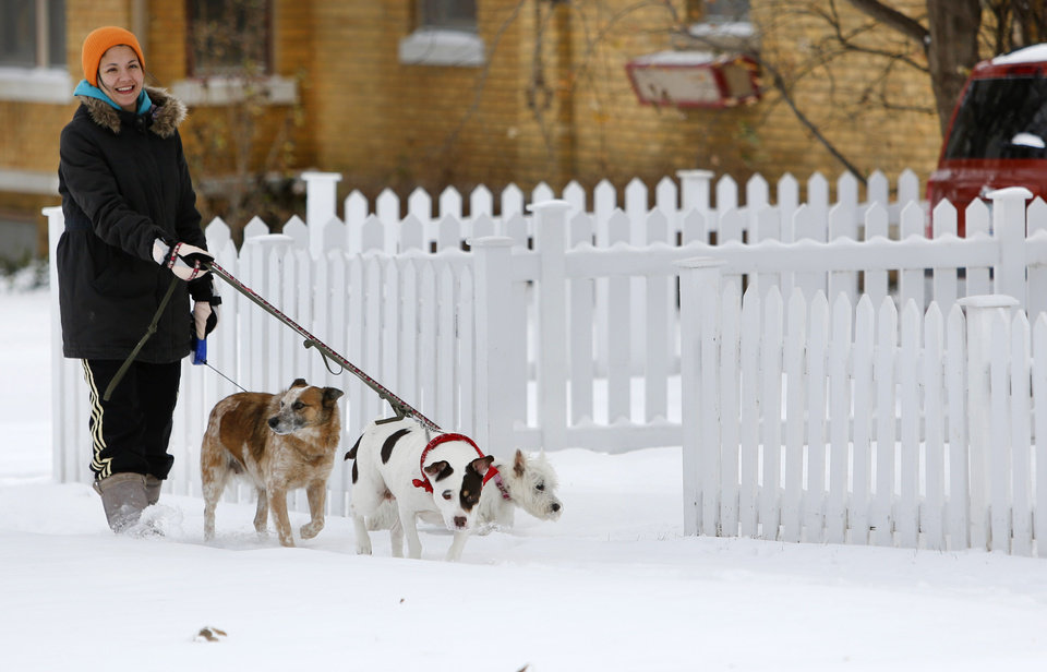 Amee Corbitt walks her dogs on Poplar Avenue in Yukon, Thursday December 6, 2013. Photo By Steve Gooch, The Oklahoman