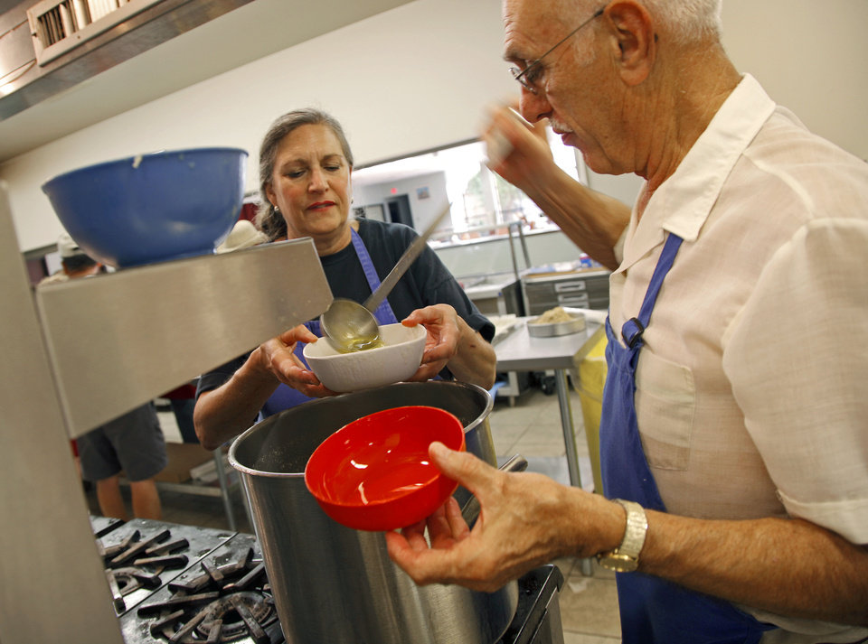 Alex Perakis dishes out butter for Susan Vassilakos as they make Baklava at St. George's Greek Orthodox Church in Oklahoma City, Saturday, Sept. 1, 2012. Photo by Bryan Terry