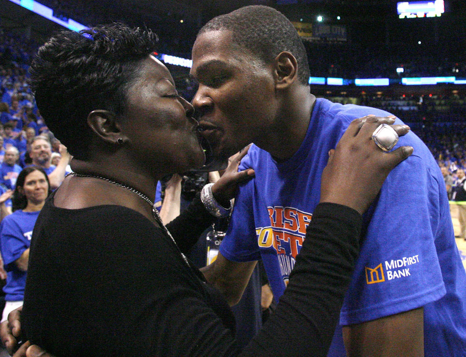 Oklahoma City Thunder forward Kevin Durant, right, kisses his mother, Wanda Pratt, following Game 7 of a second-round NBA basketball playoff series against the Memphis Grizzlies on May 15, 2011 in Oklahoma City. <strong>Sue Ogrocki - AP</strong>