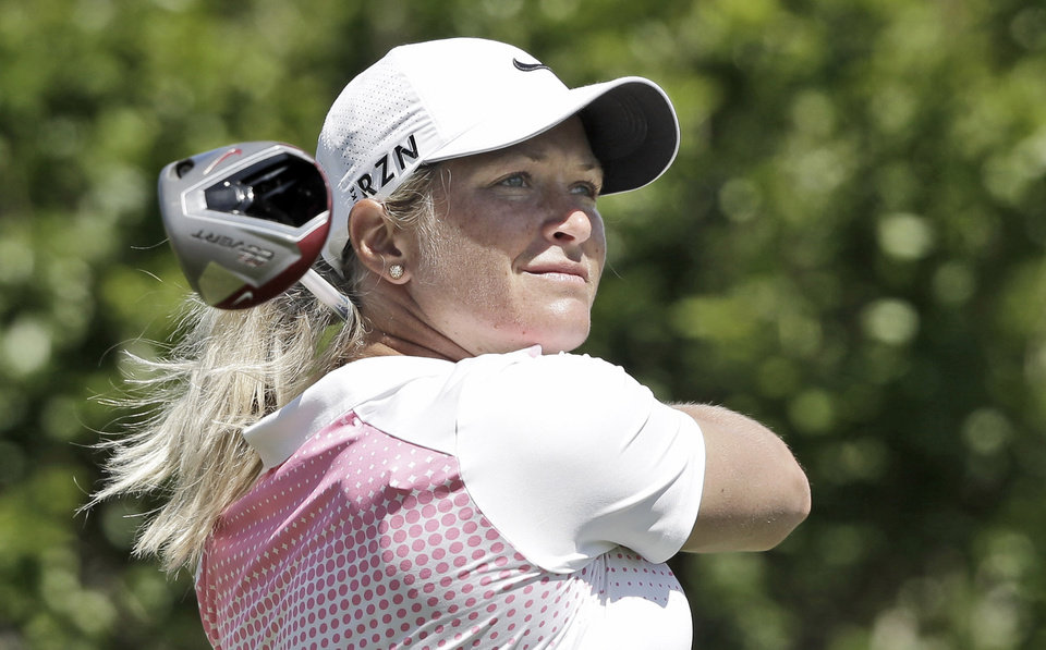 Photo - Suzann Petterson, of Norway, watchers her tee shot on the second hole during the third round of the North Texas LPGA Shootout golf tournament at the Las Colinas Country Club in Irving, Texas, Saturday, May 3, 2014. (AP Photo/LM Otero)