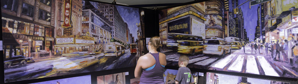 Jacki and James Winn, Edmond, look through artist Roger Disney's city scapes during the last day of the Festival of the Arts, Sunday, April 28, 2013. Disney is an Oklahoma City native who now lives in Tulsa. Photo by Doug Hoke, The Oklahoman