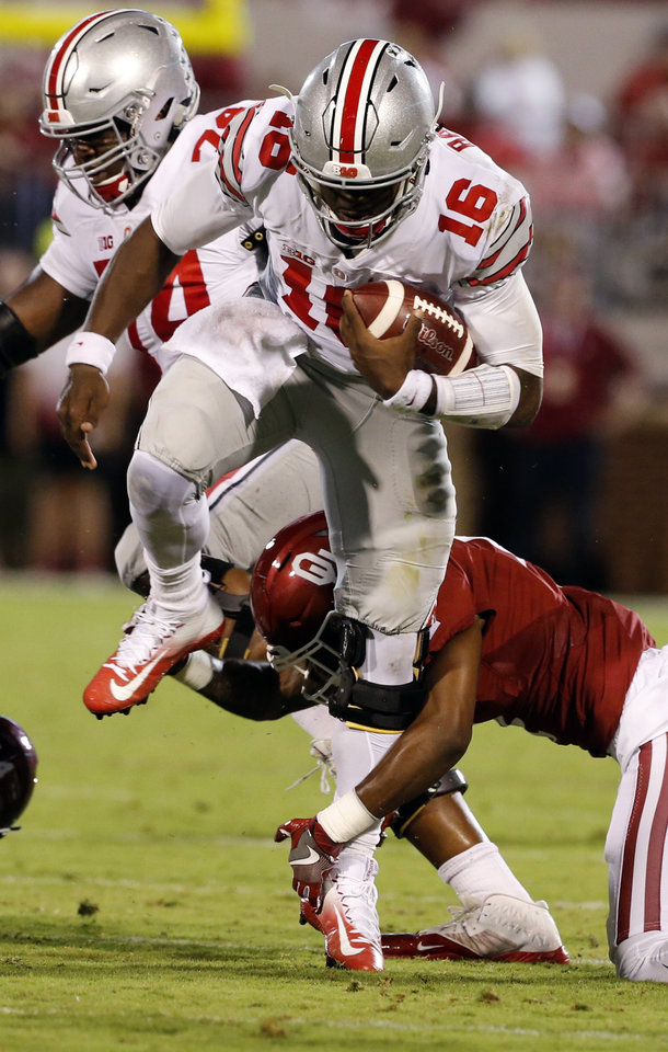 Photo - Ohio State quarterback J.T. Barrett carries the ball during a college football game between the University of Oklahoma Sooners (OU) and the Ohio State Buckeyes at Gaylord Family-Oklahoma Memorial Stadium in Norman, Okla., on Saturday, Sept. 17, 2016. Photo by Steve Sisney, The Oklahoman