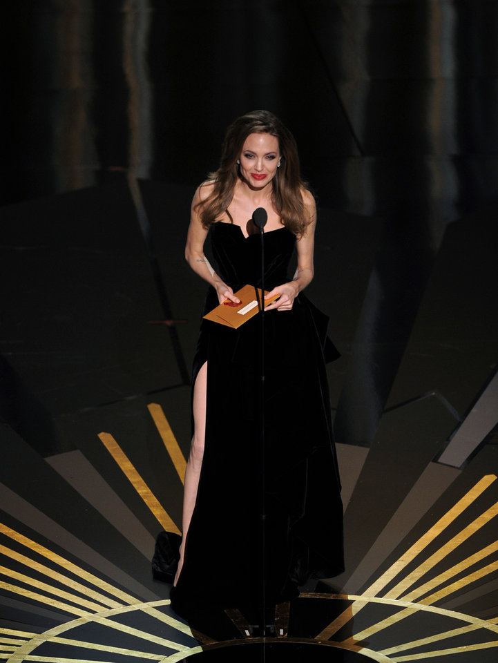 Angelina Jolie presents an award during the 84th Academy Awards on Sunday, Feb. 26, 2012, in the Hollywood section of Los Angeles. (AP Photo/Mark J. Terrill) ORG XMIT: SHO165