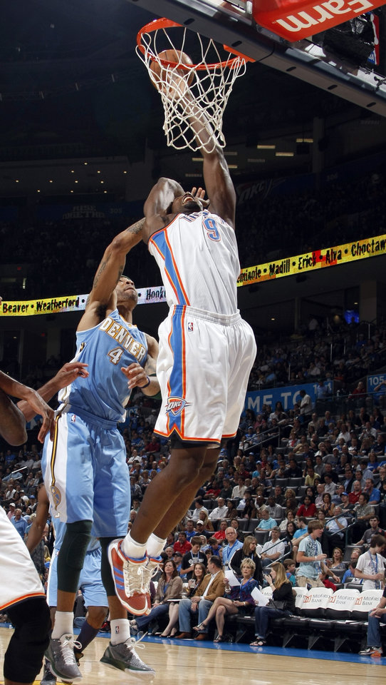 Photo - Oklahoma City's Serge Ibaka (9) shoots as Denver's Kenyon Martin (4) defends during the NBA basketball game between the Oklahoma City Thunder and the Denver Nuggets, Friday, April 8, 2011, at the Oklahoma City Arena.. Photo by Sarah Phipps, The Oklahoman