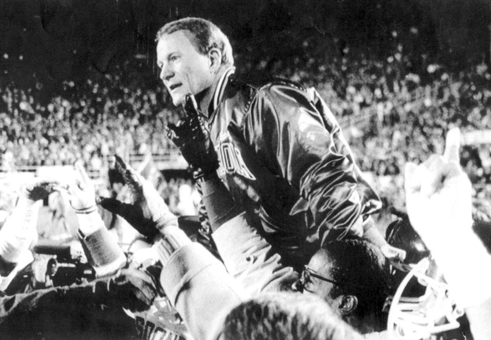 OU head football coach Barry Switzer is carried off the field by players in Lincoln, Nebraska after winning in 1984.  Staff photo taken by George R. Wilson taken 11-17-84 and ran in the 11-18-84 Daily Oklahoman. <strong>GEORGE R. WILSON 1984</strong>