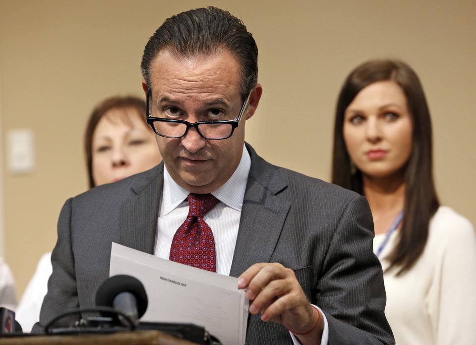 Photo -  State Health Department Interim Commissioner Preston Doerflinger provides an initial assessment of the current financial status and the future path forward for the agency at the Cleveland County Health Department on Monday in Norman. [Photo by Steve Sisney, The Oklahoman]