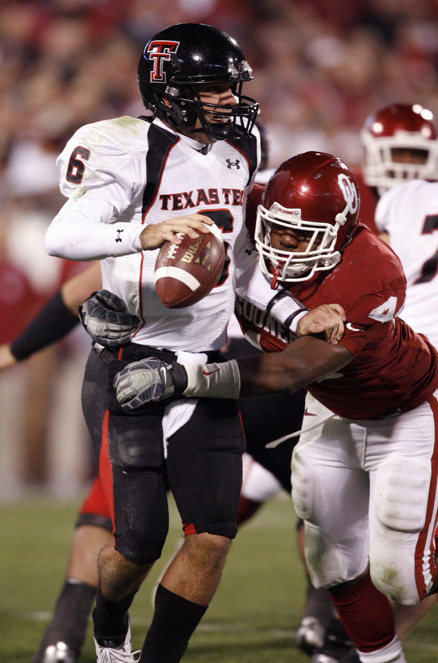 Photo - Texas Tech quarterback Graham Harrell (6) is in the grasp of Jeremy Beal during the second half of the college football game between the University of Oklahoma Sooners and Texas Tech University at the Gaylord Family -- Oklahoma Memorial Stadium on Saturday, Nov. 22, 2008, in Norman, Okla.   BY STEVE SISNEY, THE OKLAHOMAN