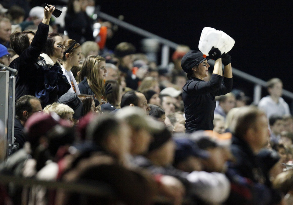Photo - Wayne fans watch the field during a high school football playoff game between Wayne and Minco in Wayne, Okla., Friday, Nov. 25, 2011. Photo by Nate Billings, The Oklahoman