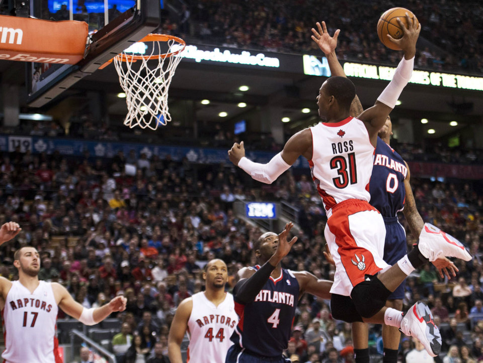 Photo - Toronto Raptors forward Terrence Ross (31) slam dunks the ball against the Atlanta Hawks during the first half of an NBA basketball game in Toronto on Sunday, March 23, 2014. (AP Photo/The Canadian Press, Nathan Denette)
