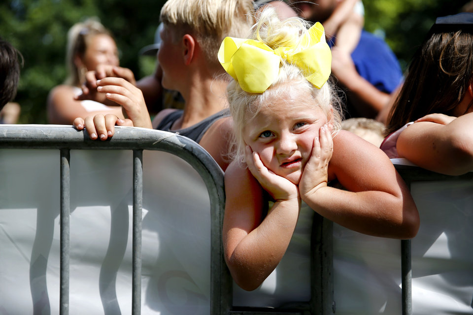 Photo - Aubree Wilson, 5, of Little Axe, Okla., waits for the start of an eating contest during the Okie Noodling Tournament and Festival at Wacker Park in Pauls Valley, Okla., Saturday, June 15, 2019. [Bryan Terry/The Oklahoman]