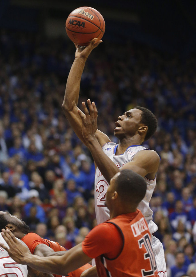 Photo - Kansas guard Andrew Wiggins (22) shoots over Texas Tech forward Jaye Crockett (30) during the first half of an NCAA college basketball game in Lawrence, Kan., Wednesday, March 5, 2014. (AP Photo/Orlin Wagner)