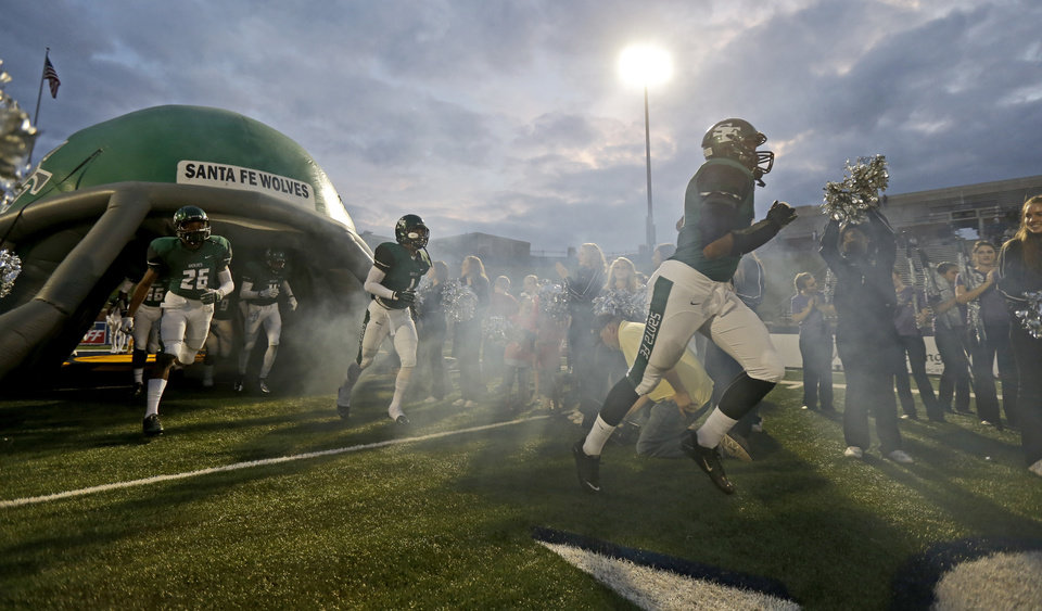 Photo - Edmond Santa Fe takes the field before their  their high school football game against Lawton at Wantland Stadium in Edmond, Okla., Thursday, October 11, 2012. Photo by Bryan Terry, The Oklahoman
