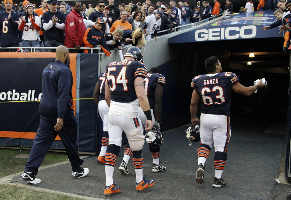 In this Dec. 2, 2012, photo, Chicago Bears linebacker Brian Urlacher (54) walks off the field following their 23-17 overtime loss to the Seattle Seahawks in an NFL football game in Chicago. Urlacher's status for this Sunday's game against the Minnesota Vikings and beyond is in question after he was injured on the final drive of their game against the Seahawks. The Chicago Tribune, citing sources, reported Tuesday, Dec. 4, that he is expected to miss three games and possibly the rest of the regular season. (AP Photo/Nam Y. Huh)