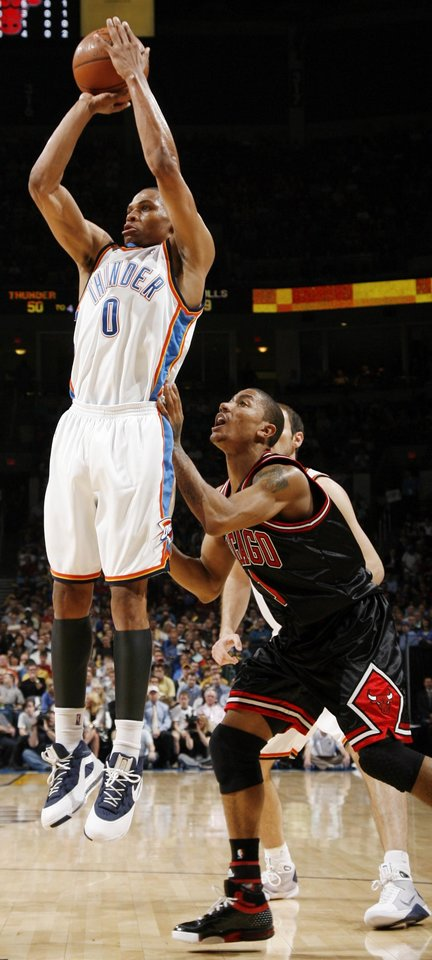 Oklahoma City's Russell Westbrook (0) shoots in front of Chicago's Derrick Rose (1) in the first half of the NBA basketball game between the Chicago Bulls and the Oklahoma City Thunder at the Ford Center in Oklahoma City, Wednesday, March 18, 2009. PHOTO BY NATE BILLINGS, THE OKLAHOMAN