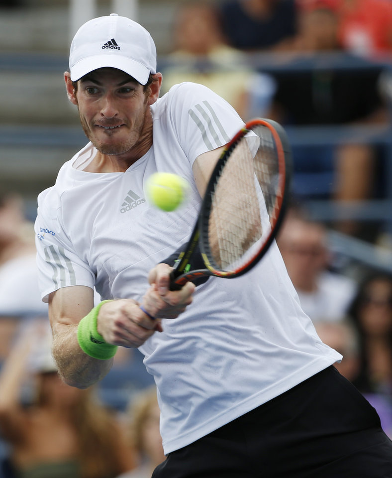 Photo - Andy Murray, of the United Kingdom, returns a shot against Andrey Kuznetsov, of Russia, during the third round of the 2014 U.S. Open tennis tournament, Saturday, Aug. 30, 2014, in New York. (AP Photo/Kathy Willens)