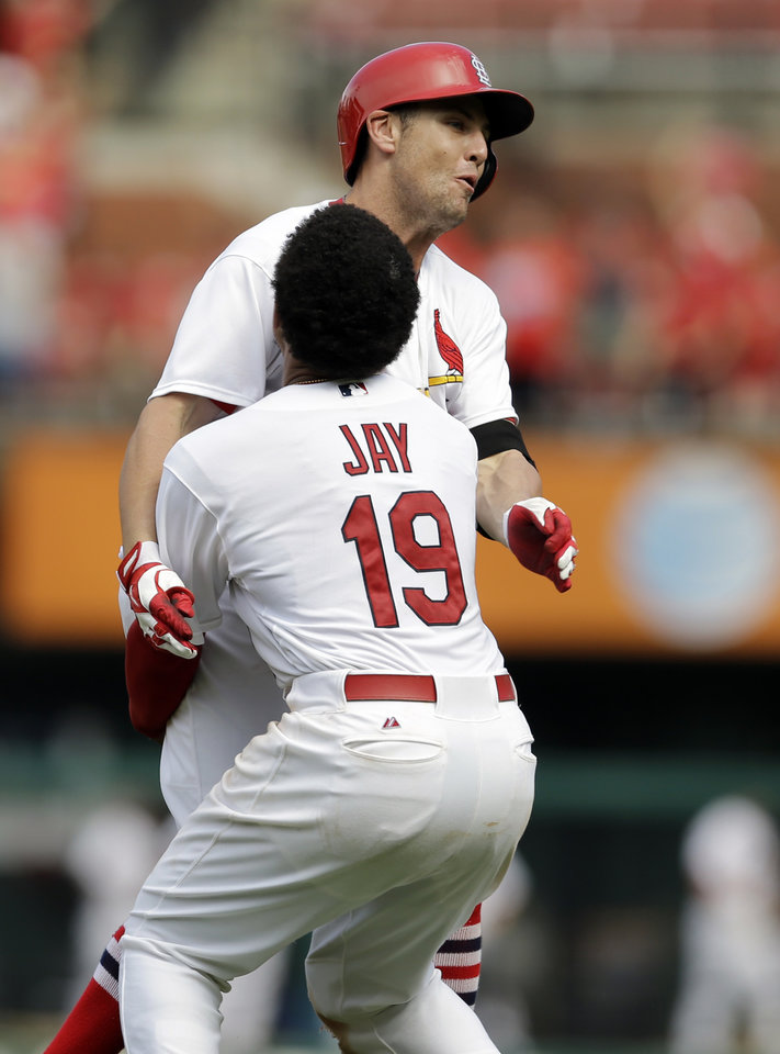 Photo - St. Louis Cardinals' Peter Bourjos is congratulated by teammate Jon Jay (19) after hitting a walk-off single to score Yadier Molina during the ninth inning of a baseball game against the Pittsburgh Pirates Wednesday, Sept. 3, 2014, in St. Louis. The Cardinals won 1-0. (AP Photo/Jeff Roberson)