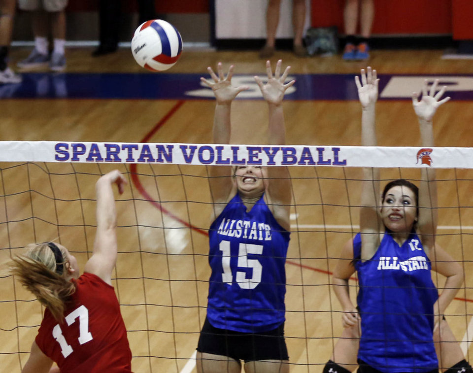 Photo - Small East's Bristen Graves (15), of Okay, and Paige Perkins (12), of Union,  defend a hit by the West's Brooke Wayman (17) of Oklahoma Bible, during the all-state volleyball play at Whitey Ford Gymnasium at Bixby High School, on Tuesday, July 30, 2013. CORY YOUNG/Tulsa World