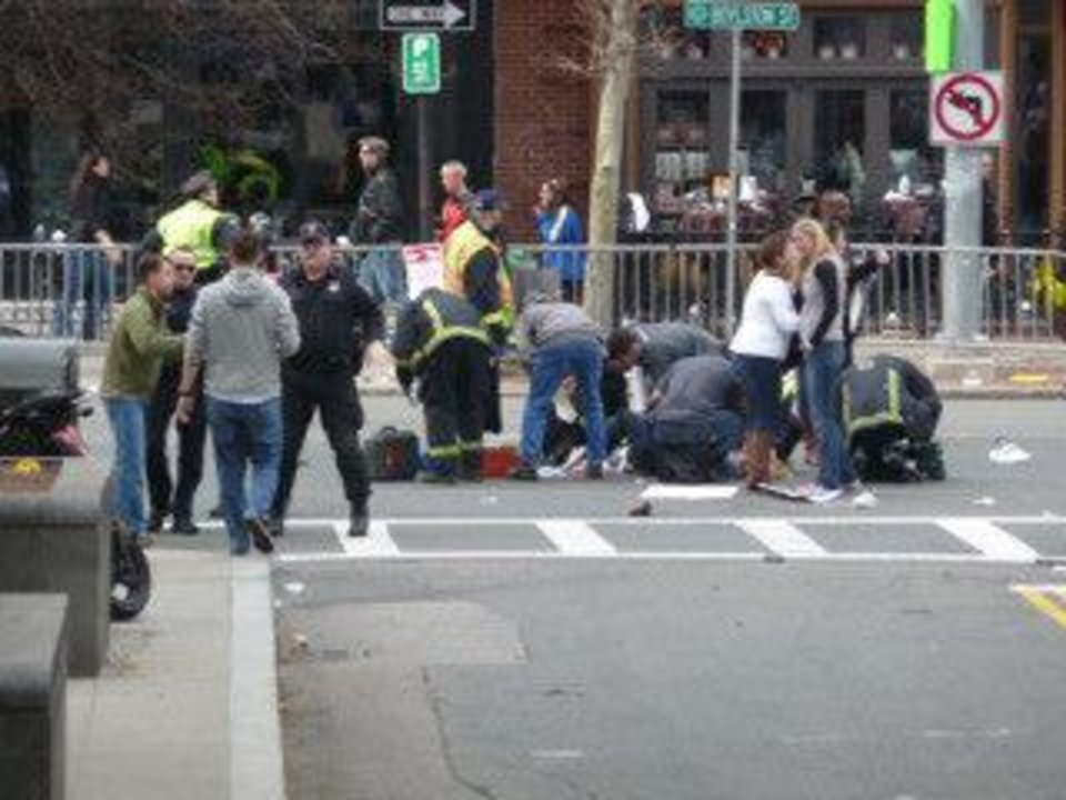 Photo - A spectator down in the intersection of Boylston Street and Ring Road after the second explosion at the Boston Marathon. Chau Smith and other runners were held at mile 25+. Photo provided