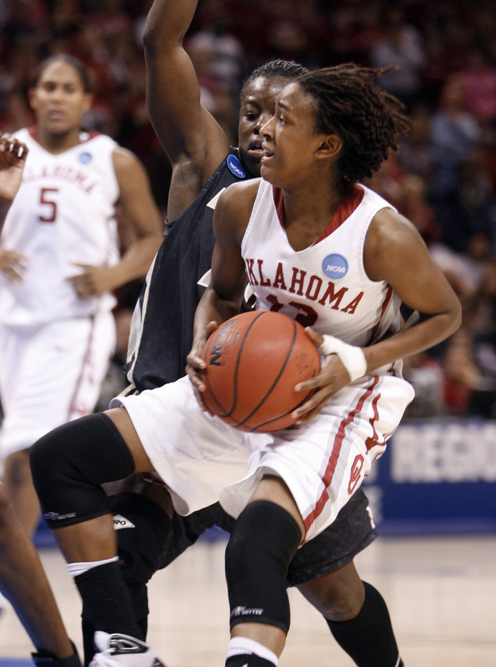 Photo - Danille Robinson drives to the bucket past FahKara Malone in the second half as the University of Oklahoma (OU) plays Purdue in the NCAA women's basketball regional tournament finals at the Ford Center in Oklahoma City, Okla., on Tuesday, March 31, 2009.  Photo by Steve Sisney, The Oklahoman