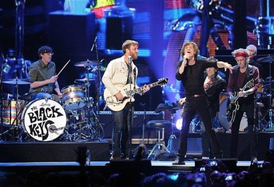Drummer Patrick Carney, left, and guitarist Dan Auerbach of the Black Keys perform with members of The Rolling Stones, from left,  Mick Jagger, Ronnie Wood, Keith Richards and Charlie Watts at the Prudential Center in Newark, NJ on Saturday, Dec. 15, 2012. (Photo by Evan Agostini/Invision/AP)
