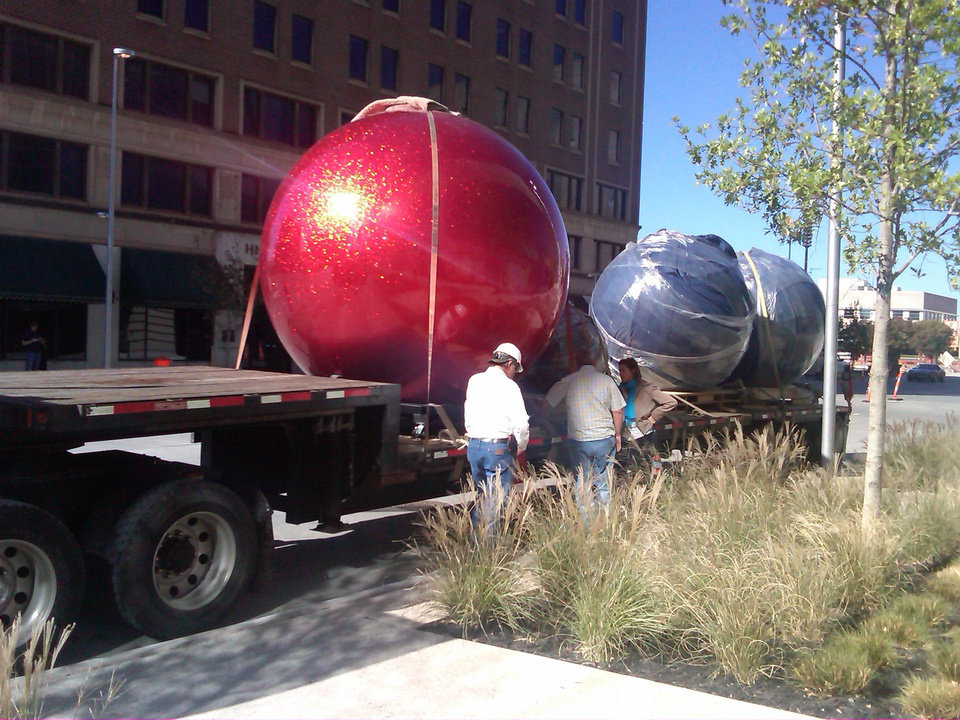 Christmas decorations begin arriving Tuesday morning at Devon Energy Center. Photo Provided