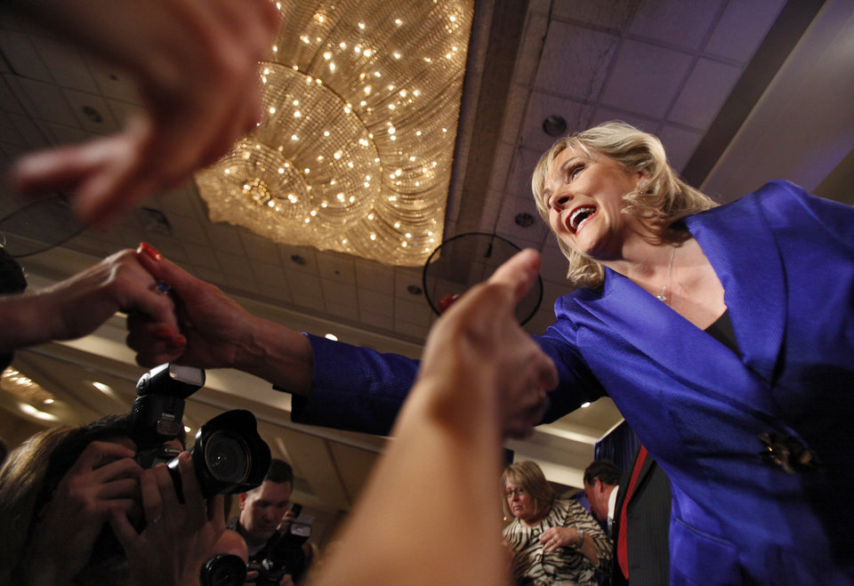 Photo - Governor elect Mary Fallin shakes hands with supporters as they celebrate her win over Jari Askins at the republican Watch Party at the Marriott on Tuesday, Nov. 2, 2010, in Oklahoma City, Okla.   Photo by Chris Landsberger, The Oklahoman