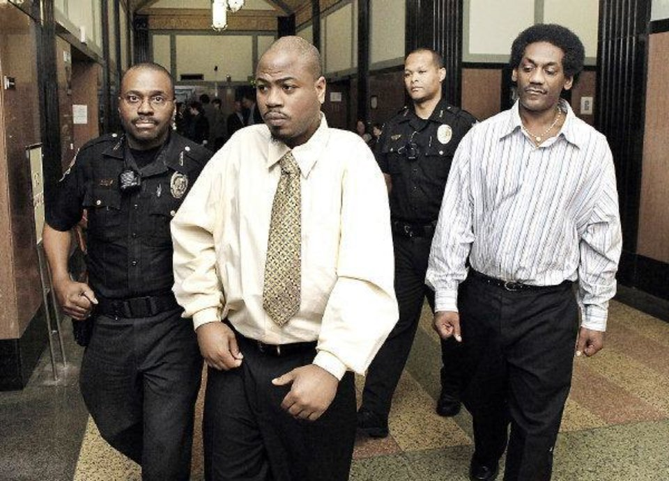 Oklahoma County sheriff deputies escort Emanuel Mitchell, left, and Anthony Morrison, right, to the courtroom for their trial at the Oklahoma County Courthouse in Oklahoma City Monday, May 2, 2011. Photo by Paul B. Southerland, The Oklahoman ORG XMIT: KOD