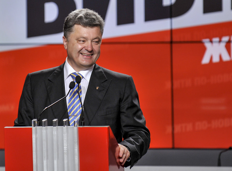 Photo - Ukrainian presidential candidate Petro Poroshenko  smiles during his press conference in Kiev, Ukraine, Sunday, May 25, 2014. An exit poll showed that billionaire candy-maker Petro Poroshenko won Ukraine's presidential election outright Sunday in the first round — a vote that authorities hoped would unify the fractured nation. (AP Photo/Mykola Lazarenko, Pool)