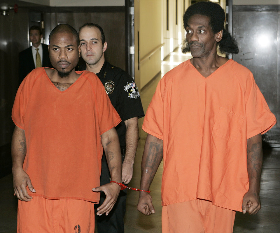 Photo - PHARMACY SHOOTING: Emanuel Mitchell and Anthony Morrison are taken into Judge Fred Doak's courtroom in the Oklahoma County Courthouse in Oklahoma City, Oklahoma September 25, 2009. Photo by Steve Gooch, The Oklahoman ORG XMIT: KOD