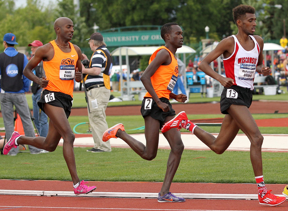 Photo -  Oklahoma State distance runner Shadrack Kipchirchir (middle) had never run competitively before coming to the United States from Kenya five years ago. This spring, he scored a pair of top-10 finishes at the NCAA Track and Field Championships, including finishing ninth in the 5,000 meters.    -  Rick Morgan
