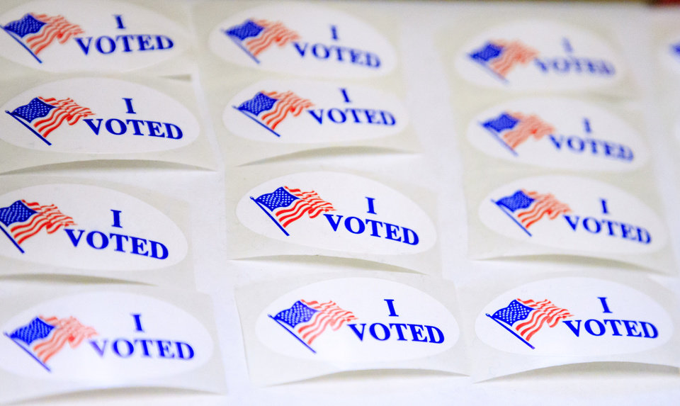 Photo - Stickers for voters after they filled out their ballots during early voting period at the Oklahoma County Election Board in Oklahoma City, Okla. on Thursday, Nov. 1, 2018.  [Photo by Chris Landsberger, The Oklahoman archives]