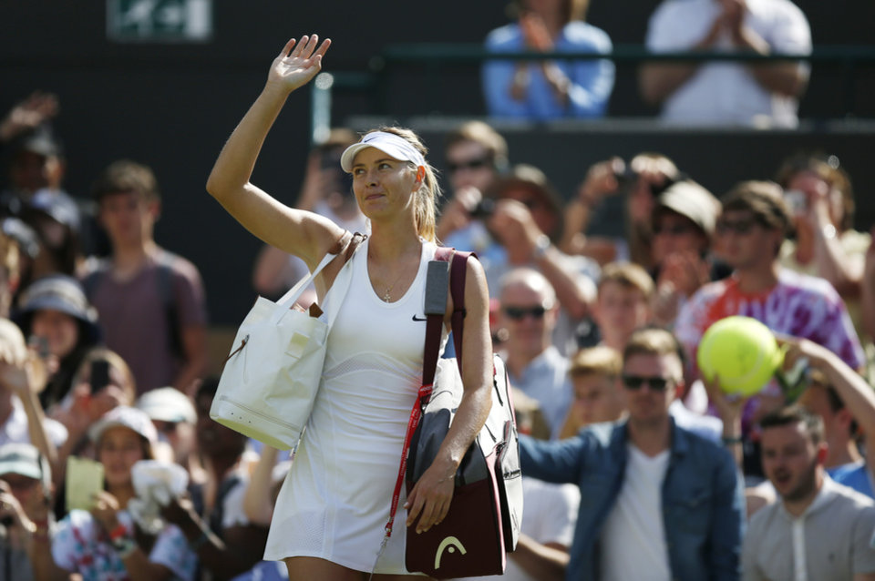Photo - Maria Sharapova of Russia waves after winning  against Samantha Murray of Britain  during their first round match at the All England Lawn Tennis Championships in Wimbledon, London,  Tuesday, June  24, 2014. (AP Photo/Pavel Golovkin)