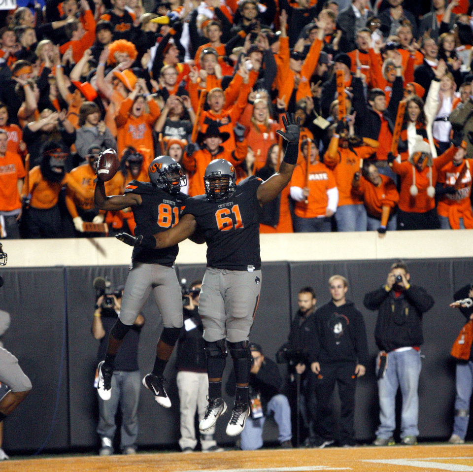 Oklahoma State\'s Justin Blackmon (81) and Michael Bowie (61) celebrate a Blackmon touchdown during a college football game between the Oklahoma State University Cowboys (OSU) and the Kansas State University Wildcats (KSU) at Boone Pickens Stadium in Stillwater, Okla., Saturday, Nov. 5, 2011. Photo by Sarah Phipps, The Oklahoman