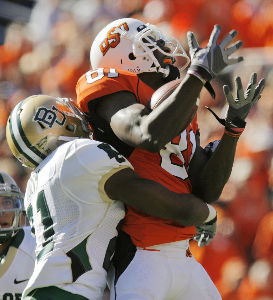 OSU's Justin Blackmon (81) tries to make a catch as Clifton Odom (21) of Baylor defends in the second quarter during the college football game between the Oklahoma State University Cowboys (OSU) and the Baylor University Bears at Boone Pickens Stadium in Stillwater, Okla., Saturday, Nov. 6, 2010. Blackmon did not make the catch, however, Odom was called for pass interference. Photo by Nate Billings, The Oklahoman