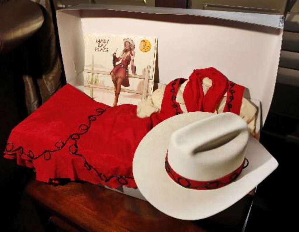 "Shown are two of the items Mary Kay Place is donating to the proposed OKPOP Museum: the hat and costume she wore in the television show, "" Mary Hartman, Mary Hartman,"" and a vinyl recording of her 1977 album, ""Aimin' To Please."" Photo by Jim Beckel, The Oklahoman."