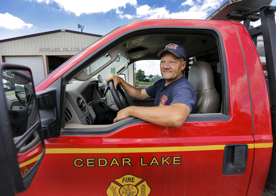 Photo - Randy Gipson is shown Tuesday at the Cedar Lake Volunteer Fire Department, east of Hinton in Canadian County. As a result of a clerical oversight, the land on which the fire department's station is located was included in a county land auction.  and was sold to a Canadian County employee. Gipson is shown at the station on Tuesday, June 3, 2014.   Photo by Jim Beckel, The Oklahoman   Jim Beckel - THE OKLAHOMAN