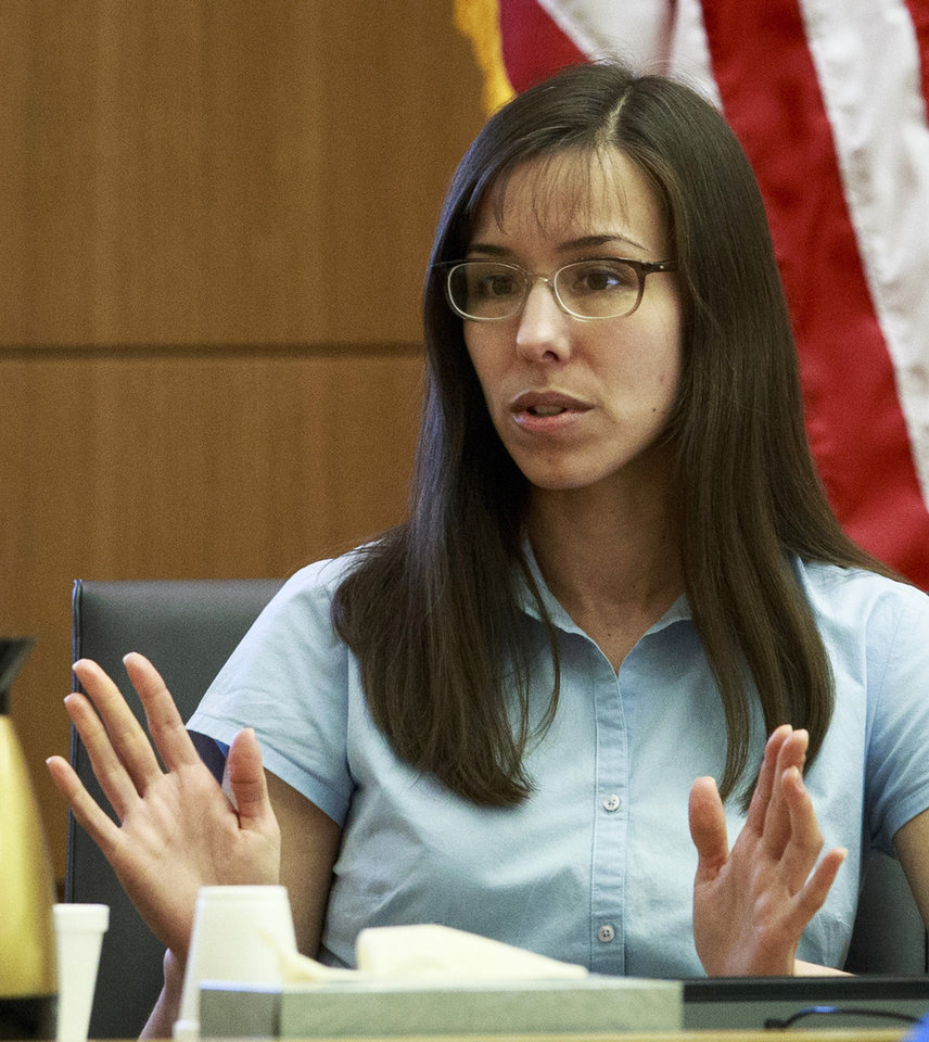 Photo - Defendant Jodi Arias  testifies on her behalf during her murder trial ins Superior Court  on Tuesday, Feb. 5, 2013 in Phoenix.    Arias is accused of murdering her lover, Travis Alexander at his Mesa, Ariz.,  home in 2008.      (AP Photo/The Arizona Republic,Charlie Leight) Maricopa County Out No Sales