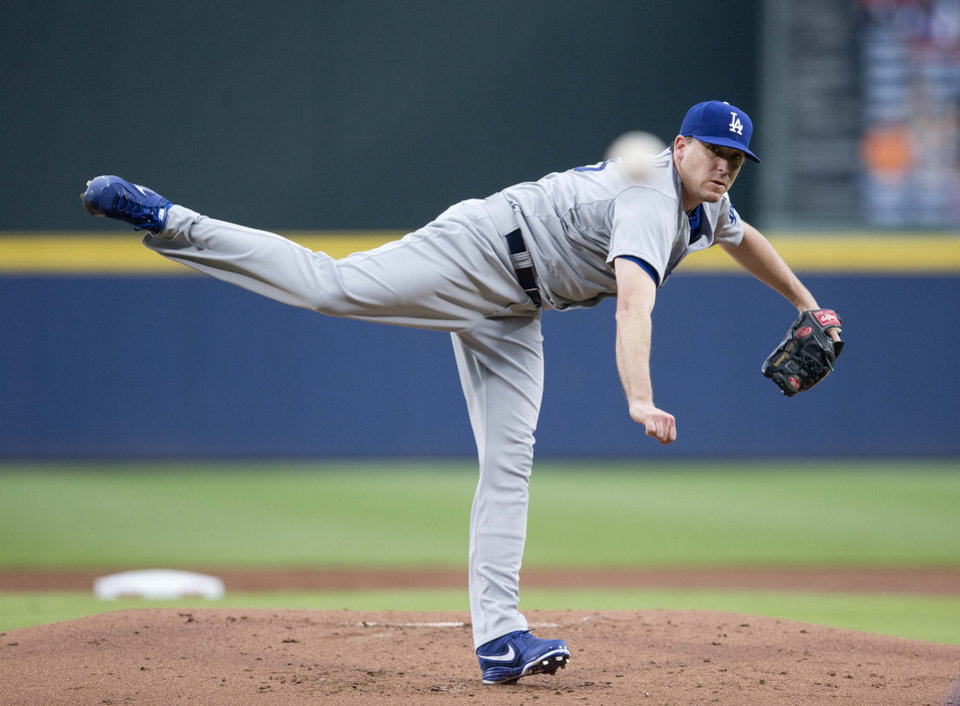 Photo - Los Angeles Dodgers starter Kevin Correia works against the Atlanta Braves  in the first inning of a baseball game  Monday, Aug. 11, 2014, in Atlanta.  (AP Photo/John Bazemore)