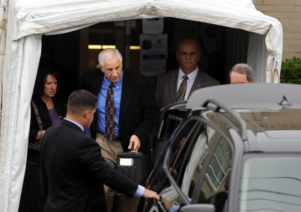 Photo -   Jerry Sandusky leaves the Centre County Courthouse, in Bellefonte, Pa., Monday, June 18, 2012. The defense began presenting it's case in Sandusky's trial on 52 counts of child sexual abuse involving 10 boys over a period of 15 years on Monday. (AP Photo/Centre Daily Times, Nabil K. Mark)
