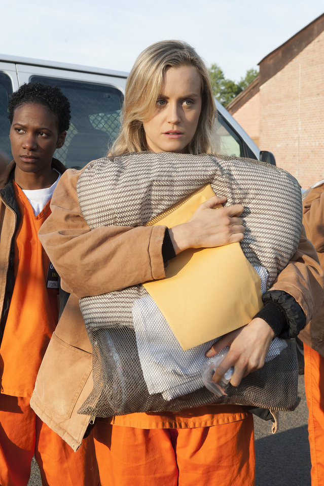 "Photo - FILE - This file image released by Netflix shows Taylor Schilling in a scene from ""Orange is the New Black."" Schilling was nominated for an Emmy Award for best actress in a comedy series on Thursday, July 10, 2014. The 66th Primetime Emmy Awards will be presented Aug. 25 at the Nokia Theatre in Los Angeles. (AP Photo/Netflix, Barbara Nitke, File)"