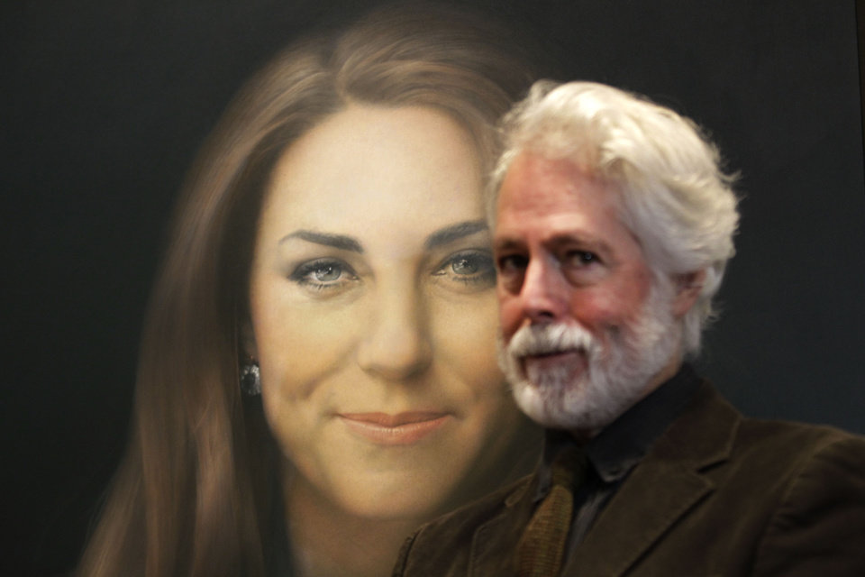 Artist Paul Emsley poses for photographers next to his newly-commissioned portrait of Kate, Duchess of Cambridge, on display at the National Portrait Gallery in London, Friday, Jan. 11, 2013. (AP Photo/Sang Tan)