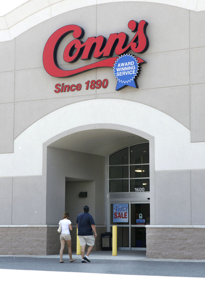 Customers enter the Conn\'s store in Edmond, OK, Thursday, July 1, 2010. By Paul Hellstern, The Oklahoman