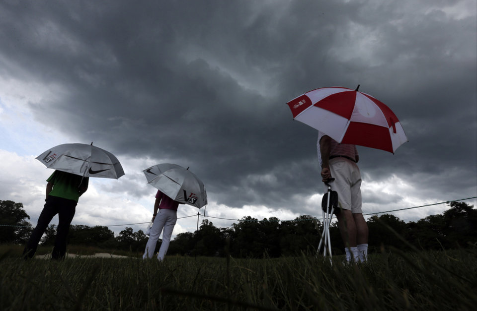 Photo - Spectators watch play during the first round of the U.S. Open golf tournament at Merion Golf Club, Thursday, June 13, 2013, in Ardmore, Pa. (AP Photo/Charlie Riedel)